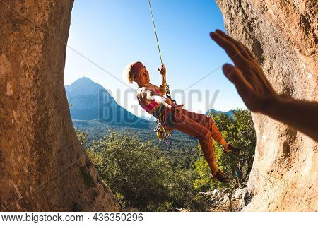 The Rock Climber Gives A High Five To His Partner, The Girl Successfully Completed The Climbing Rout