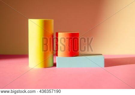Minimalistic Abstract Background. Three-dimensional Geometric Shapes: Cylinders, Rectangular Podium.