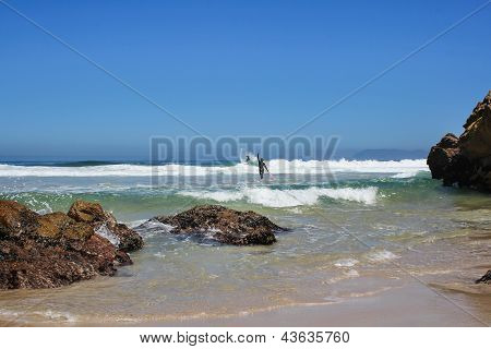 Surfers At A Beach In Sout Africa