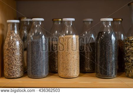 Glass Jars With Cereals In An Eco Friendly Store. The Concept Of A Grocery Store Without Plastic Dis