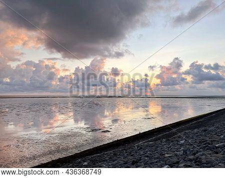 Wattenmeer, Mud Tideland In North Sea, Germany On Sunset. Nordsee, Watt.