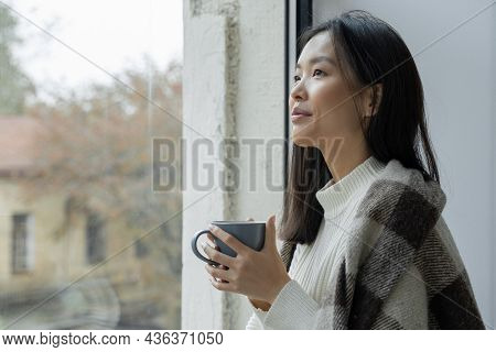 Portrait Of A Smiling Happy Cheerful Beautiful Pretty Asian Woman Drinking A Cup Of Hot Coffee Or Te