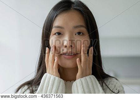 Beautiful Woman Touching Her Face By Hands. Asian Woman Looking At The Mirror With The Trouble On He