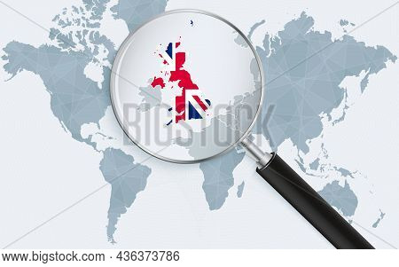 World Map With A Magnifying Glass Pointing At United Kingdom. Map Of United Kingdom With The Flag In