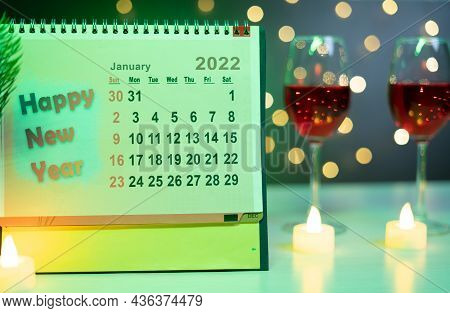 Focus On 2022 New Year Calendar, Concept Showing Of New Year Party By Champagning Drinks Behind The