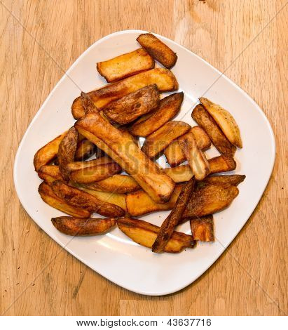 Oven Baked Potato Chips On A White Plate