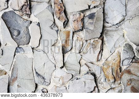 A Large Gray Stone Fence Near The House. A Nice Textural Background With A Large Gray Stone