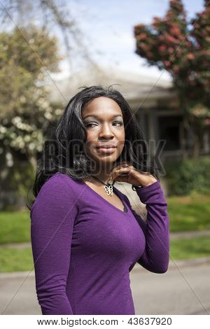 Young African American woman in a purple top. poster