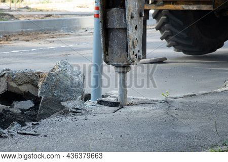 Road Repair. Removal Of An Old Layer Of Asphalt With A Hydraulic Hammer. Pavement Reconstruction.
