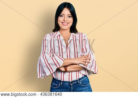 Young hispanic girl wearing casual clothes happy face smiling with crossed arms looking at the camera. positive person.