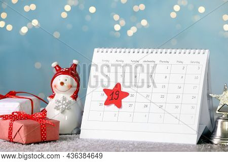 Saint Nicholas Day. Calendar With Marked Date December 19, Gift Boxes And Snowman Figure On Table Ag