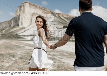 Honeymoon Trip To The Country Of The White Mountains. Couple In Love Hiking Mountains.  Capturing Be