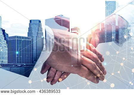 Businessman Wearing Formal Suit Is Shaking Hands With Businesswoman In White Shirt. New York City Sk