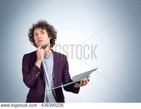 Office Man In Casual Jacket Standing With Pensive Look. Young Manager Making Up Plans And New Ideas.