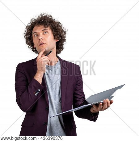 Office Man In Casual Jacket Holding Clipboard In Hands, Pensive Look, Make Up Idea And Plans. Isolat