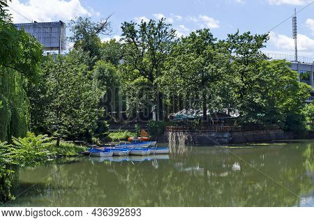 Sofia, Bulgaria -  June 21, 2021: Cosy Nook For  Relaxation With Wooden Pontoon And Boats In Lake Ar