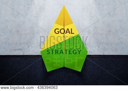 Goal, Challenge And Strategy Concept. Start A New Business. Paper Plane With Text Of Goal And Strate