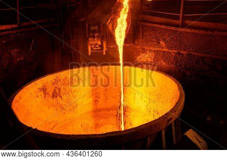 Blast Furnace Slag Tapping. The Molten Slag Is Poured Into A Ladle. Metallurgical Industry.
