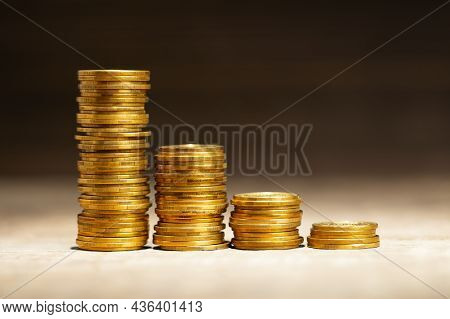 Stack Of Coins With Steps Down As A Symbol Of Failure