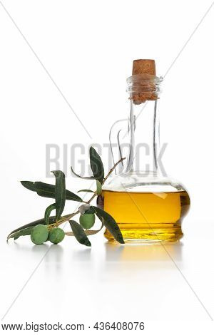 Extra Virgin Olive Oil In A Special Glass Bottle Isolated On White Background.