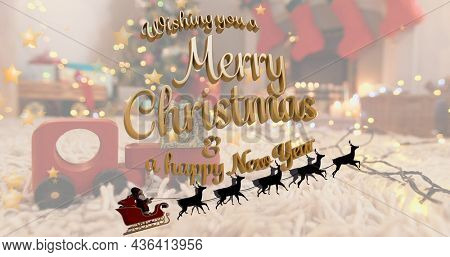 Image of merry christmas text over santa claus in sleigh with reindeer. christmas, tradition and celebration concept digitally generated image.