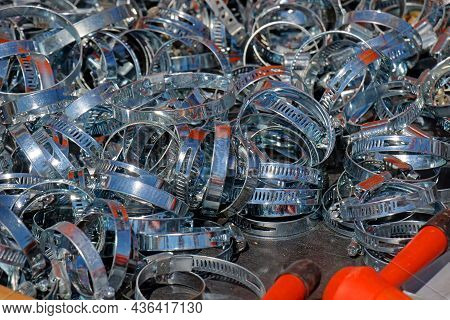 Large Pile Of Silver Metal Hose Clamps Sold On Outdoor Market