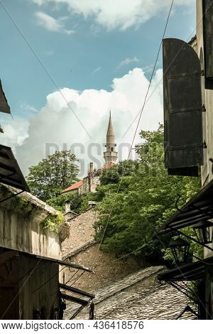 Selective Blur On A Minaret Of A Muslim Mosque In Stari Grad, The Old Town Of Mostar, With Derelict