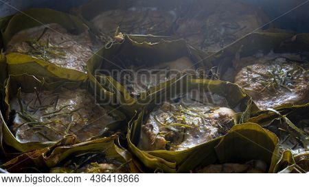 Close-up Of Thai Steamed Curry Fish In Banana Leaf Cups Or Thailand Name Hor Mok Pla. Steaming Until