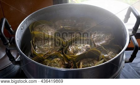 Thai Steamed Curry Fish In Banana Leaf Cups Or Thailand Name Hor Mok Pla. In Side Kitchen Implement