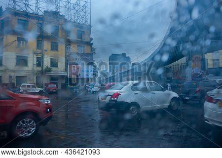 Kolkata, West Bengal, India - 25th September 2019 : Image Shot Through Raindrops Falling On Wet Glas