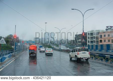 Howrah, West Bengal, India - 17th August 2019 : Image Shot Through Raindrops Falling On Car Windshie