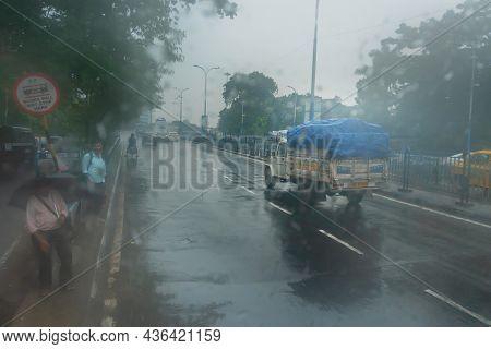 Kolkata, West Bengal, India - 17th August 2019 : Image Shot Through Raindrops Falling On Wet Glass,