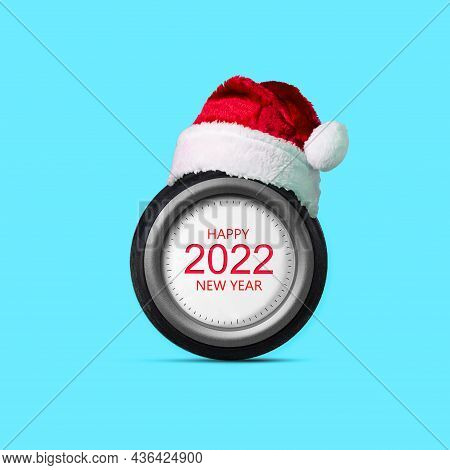 Car Wheel, 2022, Santa Claus Hat. Abstract New Year Concept Isolated On A Blue Background. Design El