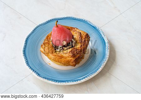 Round Fruity Croissant With Candied Pear, Bitter Chocolate And Hazelnut.