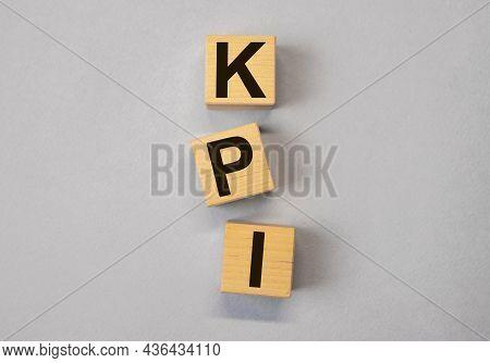 Kpi Acronym. Key Performance Indicator On Wood Cubes On Background.