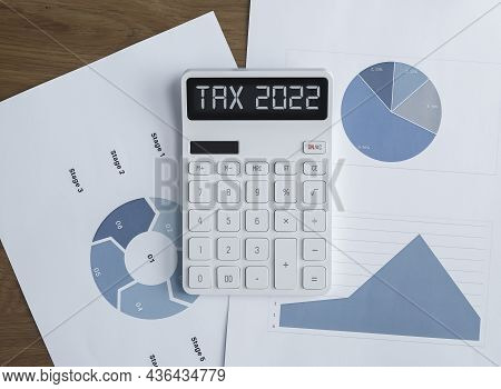 Tax 2022, Taxation System. Word On Calculator With Papers.