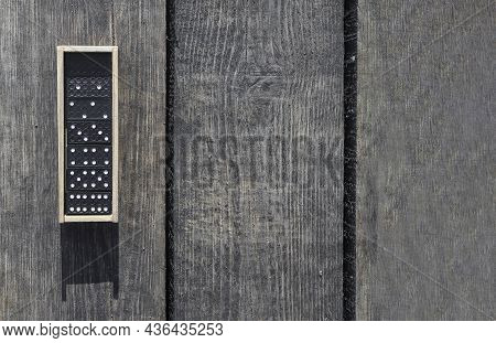 Wooden Box With Domino Game Pieces On Wood Desk. Banner With Copy Space.