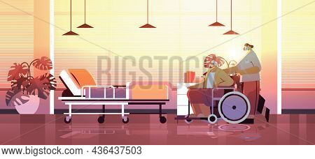 Helper Taking Care Of Senior Disabled Patient Nurse Pushing Wheelchair Care Service Concept Hospital