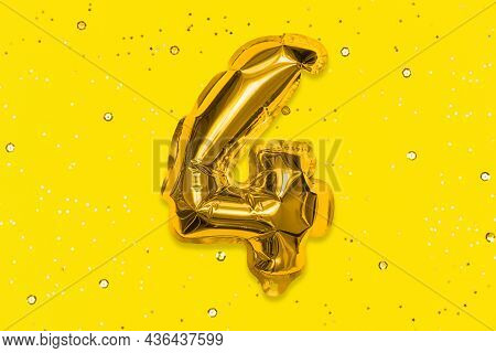 The Number Of The Balloon Made Of Golden Foil, The Number Four On A Yellow Background With Sequins.