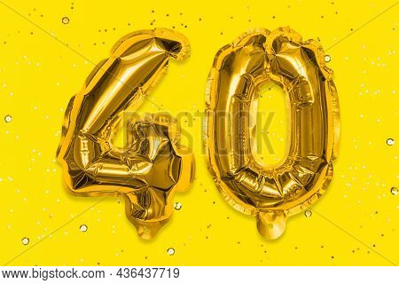 The Number Of The Balloon Made Of Golden Foil, The Number Forty On A Yellow Background With Sequins.