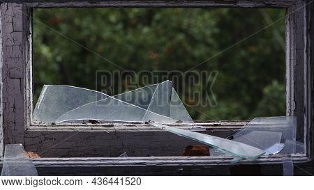 Smashed Glass Window With Old Wooden Frame. Old Window. Finely Broken Glass. Old House, Retro. Crack