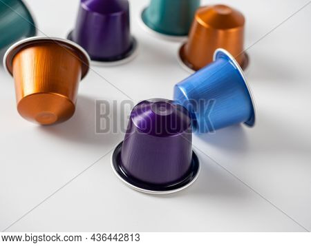 Colorful Aluminum Capsules With Ground Coffee On A White Background. Capsules For The Coffee Machine