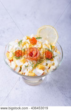 Layered Salad With Salted Trout (salmon), Caviar, Eggs And Vegetables. Traditional Dish, One Portion