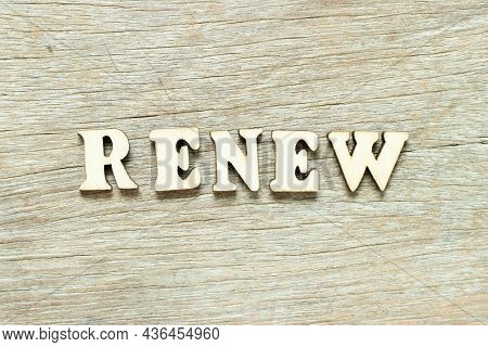 Alphabet Letter In Word Renew On Wood Background