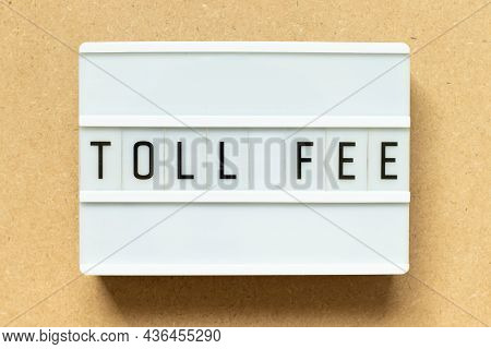 Lightbox With Word Toll Fee On Wood Background