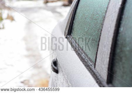 A Close-up Of A Frozen Car Door, Car Window Covered With Ice. Unfreezing, De-icing The Car Door Prop