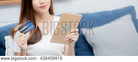 Young Asian Woman Smiling Holding Credit Card Shopping Online With Tablet Computer Buying And Paymen