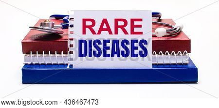 On A Light Background Notepads, A Stethoscope And A White Card With The Text Rare Diseases. Medical