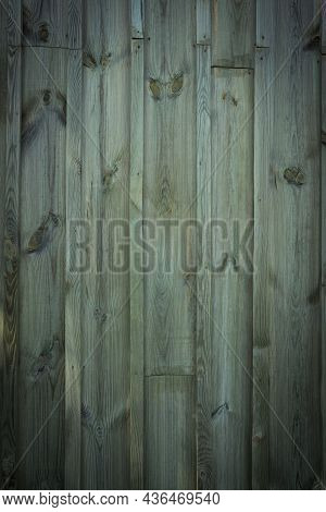 Wooden Logs Of An Old House. Close-up. Weathered Green Wood Texture. Background. Horizontal Vertical