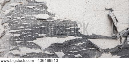 Old Black Grunge Ripped Torn Collage Posters Creased Crumpled Paper Placard On Old Wall Background